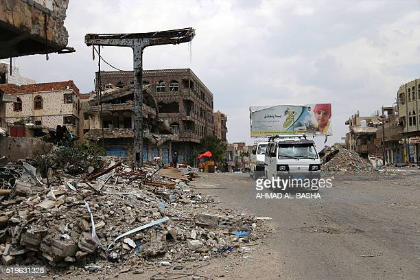 A picture taken on April 7 shows heavily damaged buildings on a street in Yemen's third city Taez as a result of clashes between Shiite Huthi rebels...