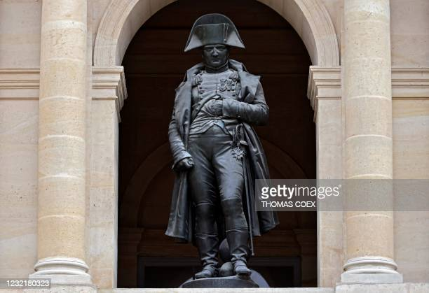 Picture taken on April 7 shows the bronze statue of French Emperor Napoleon I inside the honour yard at the Hotel des Invalides, in Paris. - The...