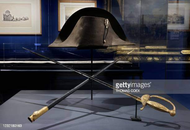 Picture taken on April 7 shows the swords and the bicorn hat of French Emperor Napoleon I displayed at the Army museum of the Hotel des Invalides, in...