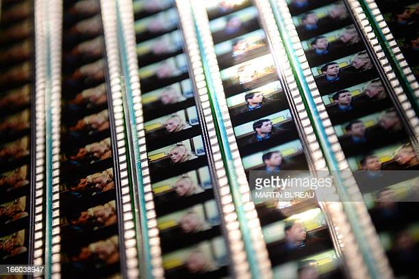 A picture taken on April 8 2013 at the Cinematheque Francaise in Paris shows frames of a film reel presented during the retrospective exhibition...