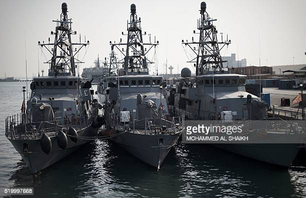 A picture taken on April 9 2016 shows US Navy ships moored ahead of the International Mine Countermeasures Exercise organised by the US Navy at its...