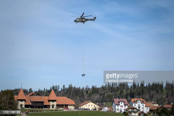 Picture taken on April 9, 2021 in Saignelegier shows a horse being airlifted during a test by Swiss army forces on hoisting horses with a helicopter....