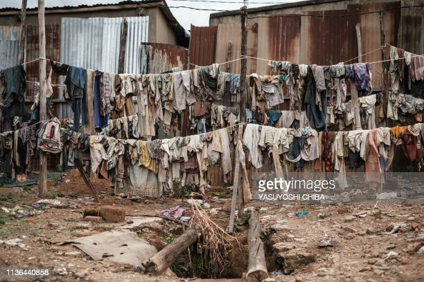 A picture taken on April 9 shows victims' clothes recovered from pits used as mass graves during the 1994 Rwandan genocide and hidden under houses in...