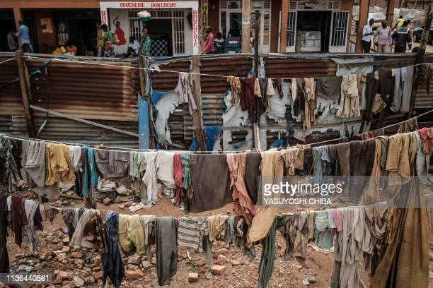 TOPSHOT A picture taken on April 9 shows victims' clothes recovered from pits used as mass graves during the 1994 Rwandan genocide and hidden under...