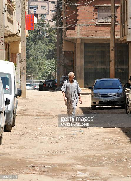 A picture taken on August 05 2009 shows an Algerian man walking near closed Chinese shops at a suburb in Bab Ezzouar 15 km east from the City center...