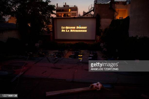 A picture taken on August 1 2020 shows the projection of the 1972 French movie Le charme Discret de la Bourgeoisie at the openair cinema Zephyros in...