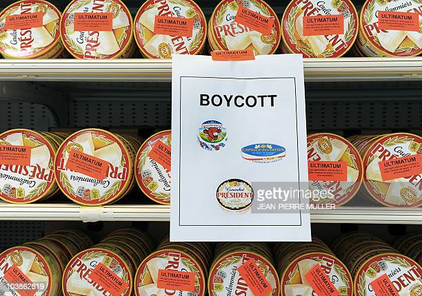 A picture taken on August 10 2010 of coulommiers cheese with boycott poster and stickers in a supermarket in Begles during a protest by farmers...