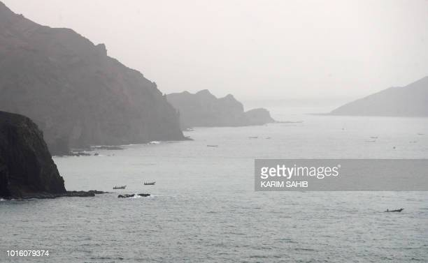 A picture taken on August 10 2018 during a trip in Yemen organised by the UAE's National Media Council shows a view of Yemeni fishing boats along the...