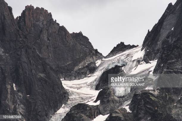 A picture taken on August 10 2018 shows a detail of Les Grands Charmoz part of the group of peaks Aiguilles de Chamonix in the Mont Blanc massif...