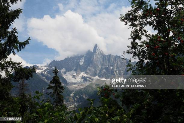 A picture taken on August 10 2018 shows l'Aiguille Verte part of the group of peaks Aiguilles de Chamonix in the Mont Blanc massif French Alps in the...