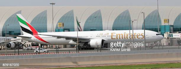 A picture taken on August 10 shows an Emirates airline Boeing 777 parked on the tarmac at Dubai airport The airlines confirmed it would sponsor the...