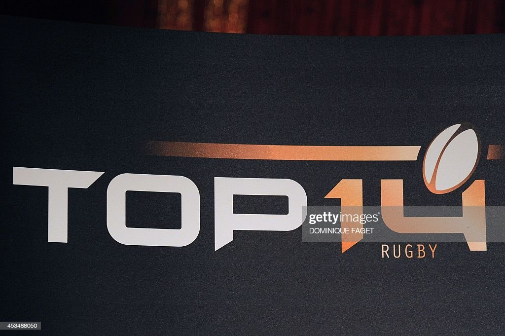 A picture taken on August 11, 2014 shows the French Top 14 rugby union logo during the Top 14 team captains' presentation to the press on August 11, 2014 in Paris.