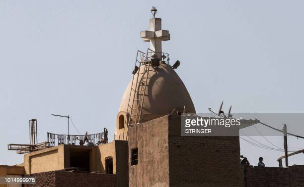 A picture taken on August 11 2018 shows a view of the dome of the Coptic Orthodox Church of the Virgin Mary in the eastern Mostorod neighbourhood of...
