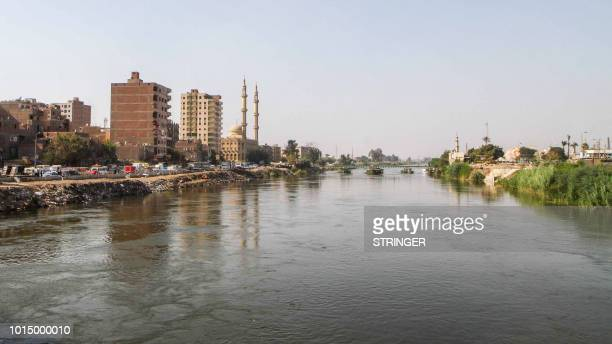 A picture taken on August 11 2018 shows a view of the Nile river banks in the eastern Mostorod neighbourhood of the district of Shubra alKheima on...