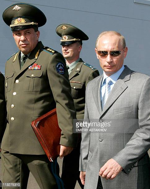 A picture taken on August 11 shows Russia's Space Troops Commander Colonel General Vladimir Popovkin and Vladimir Putin then Russian President as...