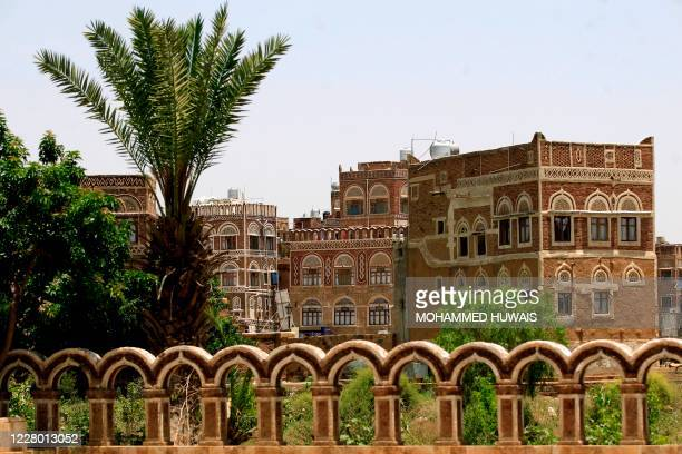 Picture taken on August 12 shows UNESCO-listed buildings in the old city of the Yemeni capital Sanaa. - Flash floods triggered by torrential rains...