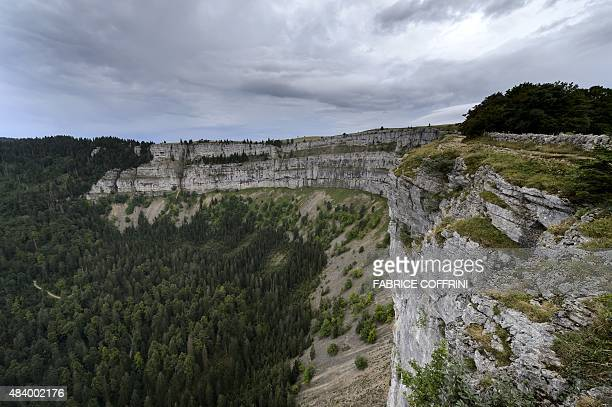 A picture taken on August 14 2015 shows the CreuxduVan cliff at the bottom of which Swiss Canton of Neuchatel police found the bodies of a man and...