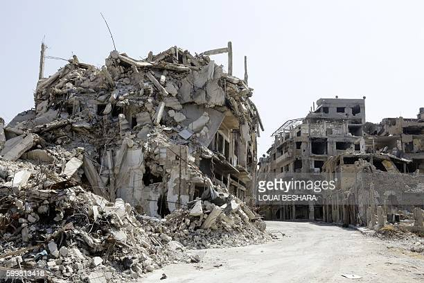 A picture taken on August 14 2016 shows collapsed and heavily damaged buildings in the alKhalediah neighbourhood of the central Syrian city of Homs...