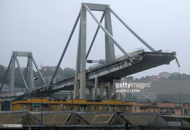 A picture taken on August 14 2018 in Genoa shows a view of the Ponte Morandi motorway bridge after one of its section collapsed injuring several...