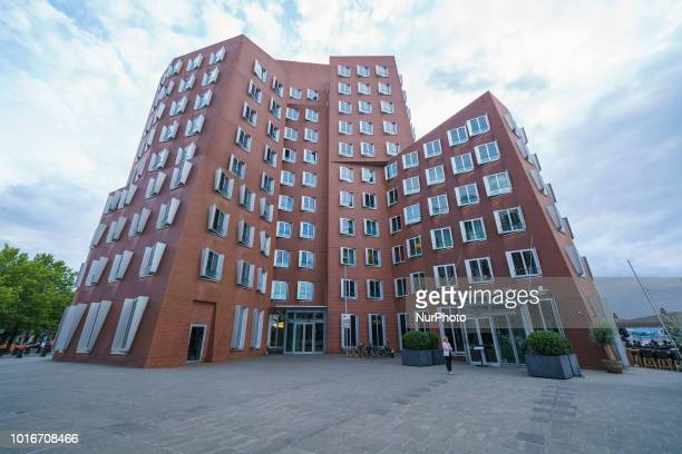 A picture taken on August 14 2018 shows a view of a trio of office building known as the Neuer Zollhof in Duesseldorf Germany Neuer Zollhof in...