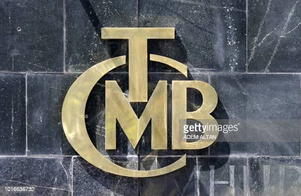 Picture taken on August 14, 2018 shows the logo of Turkey's Central Bank at the entrance of the bank's headquarters in Ankara, Turkey.
