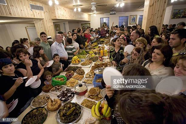 A picture taken on August 15 2007 shows Christian Iraqi refugees meeting inside Johannes Catholic church in Sodertalje in Sweden About 30000...