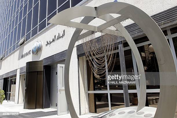 A picture taken on August 16 2014 shows the entrance of the Arab Bank's main offices in the Jordanian capital Amman Jordan's Arab Bank went on trial...