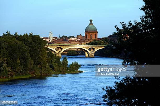 A picture taken on August 16 2015 shows the Catalans bridge over the Garonne river and the dome of the La Grave hospital in Toulouse southern France...