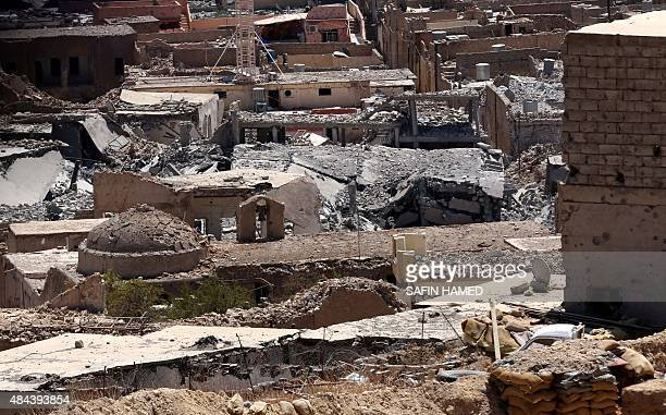 A picture taken on August 17 2015 shows buildings that were damaged during fighting between Iraqi Kurdish Peshmerga fighters and the Islamic State...