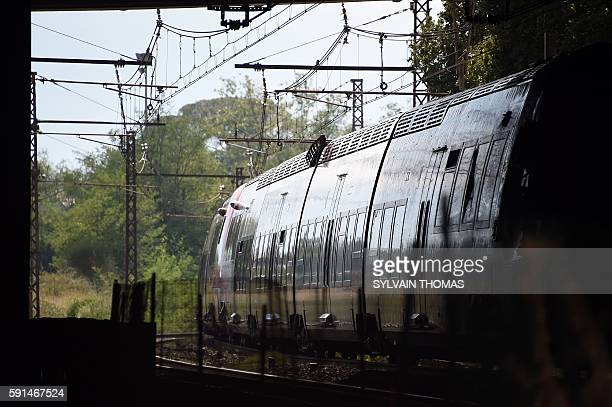 A picture taken on August 17 2016 shows a train following its crash in SaintAunes near the French city of Montpellier A train crashed into a tree...