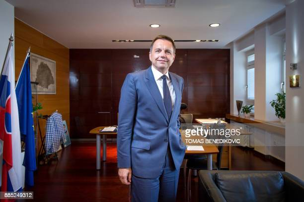Picture taken on August 17 2017 shows Slovak Finance Minister Peter Kazimir posing for a photo in his office at the Finance Ministry in Bratislava...