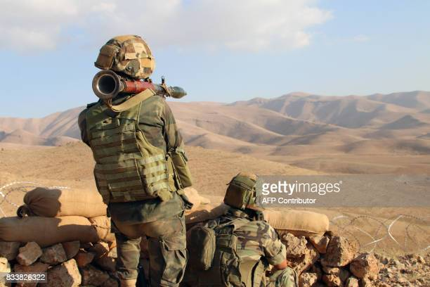 A picture taken on August 17 during a tour guided by the Lebanese army shows soldiers holding a in a mountainous area near the town of Ras Baalbek a...