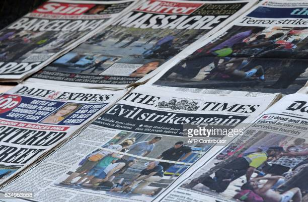 A picture taken on August 18 2017 shows frontpages of British national newspapers with stories dedicated to the Barcelona attack one day after a van...