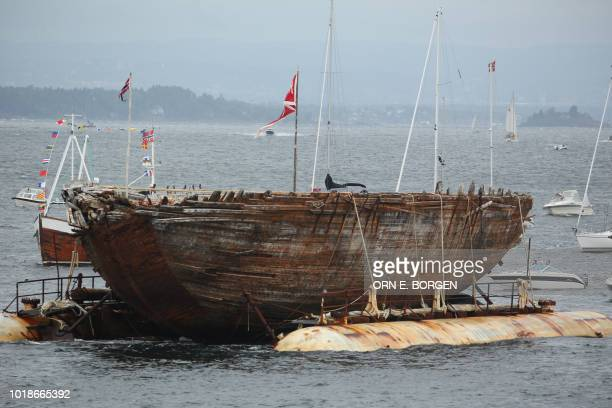 A picture taken on August 18 2018 shows the ship used by Norwegian polar explorer Roald Amundsen upon its arrival at Vollen's port at her final...