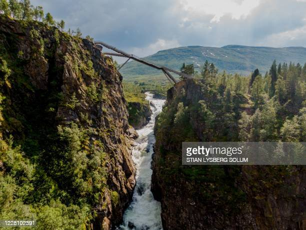 Picture taken on August 18, 2020 shows a new bridge near the Vøringsfossen waterfall close to Eifjord in Hardanger, western Norway. - The footbridge...