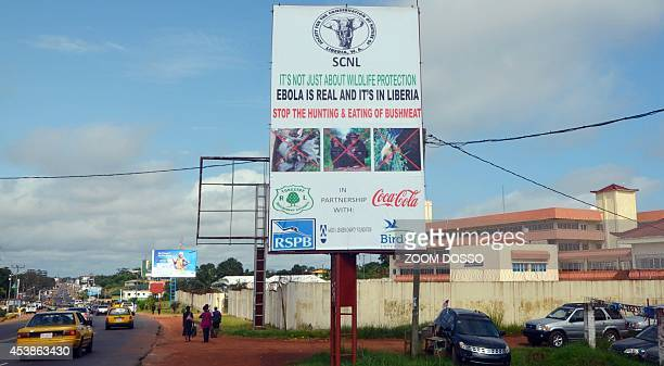 A picture taken on August 19 2014 in Monrovia show an Ebola information billboard displayed near the John F Kennedy memorial medical centre where 17...