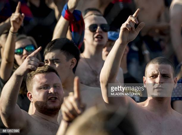 A picture taken on August 19 2017 shows supporters of Moscow's CSKA shouting slogans during the Russian Premier League football match CSKA Moscow vs...