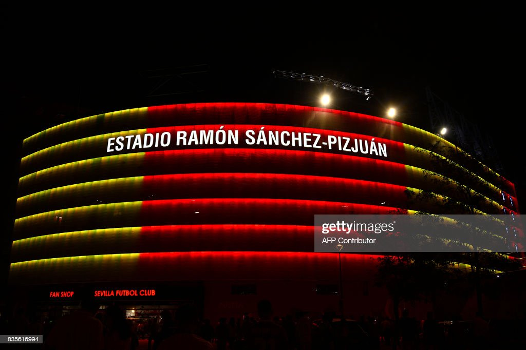 A picture taken on August 19, 2017 shows the Ramon Sanchez-Pizjuan stadium illuminated with the colours of the Catalan flag in tribute to the victims of Barcelona and Cambrils' attacks during the Spanish league football match Sevilla FC vs Espanyol. QUICLER