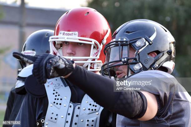 A picture taken on August 19 shows players of the Patriots American football team taking part in a training session in the small town of...