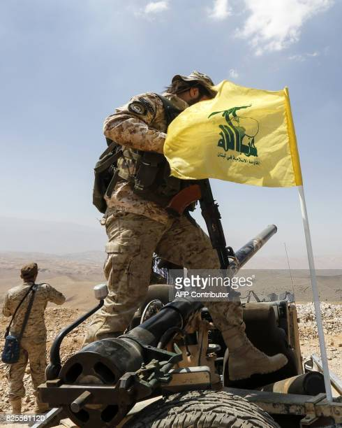 A picture taken on August 2 2017 during a tour guided by the Lebanese Shiite Hezbollah movement shows one of the group's fighters stepping on an...