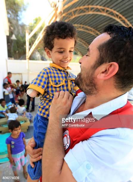 Picture taken on August 2, 2017 shows children of Islamic State group fighters currently living in the Libyan Red Crescent headquarters in Misrata, a...