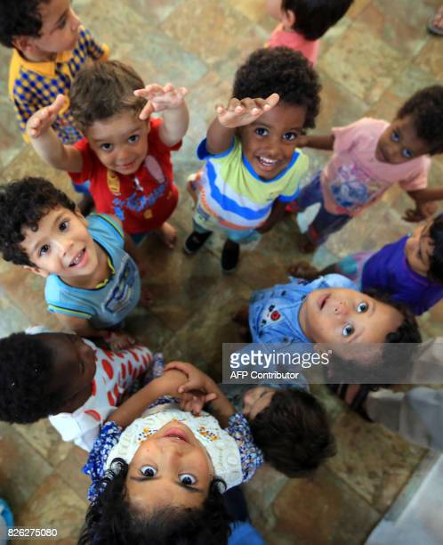 A picture taken on August 2 2017 shows children of Islamic State group fighters currently living in the Libyan Red Crescent headquarters in Misrata a...