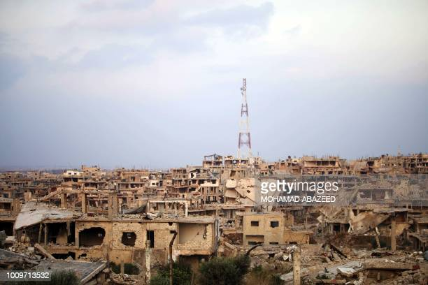 Picture taken on August 2 shwos a general view of destroyed buildings in the opposition-held southern city of Daraa.