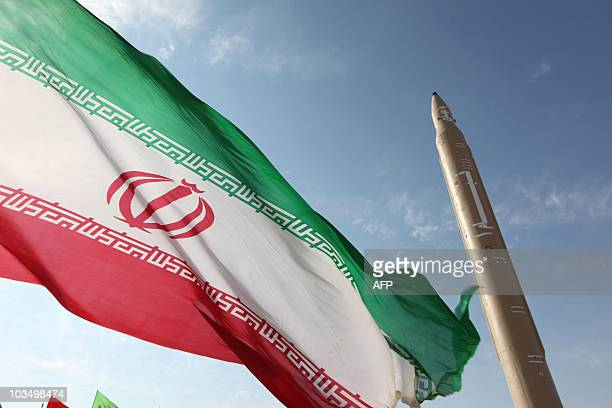 Picture taken on August 20, 2010 shows an Iranian flag fluttering at an undisclosed location in the Islamic republic next to a surface-to-surface...