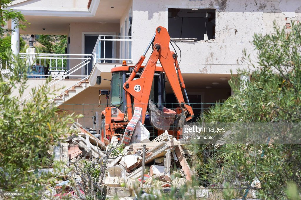A picture taken on August 20, 2017 shows a crane in the rubble of a house,where suspects of this week's twin assaults in Spain were believed to be building bombs, in Alcanar. Police said today they have found more than 120 gas canisters in a house in Alcanar, where suspects of this week's twin assaults in Spain were believed to be building bombs for 'one or more' attacks in Barcelona. On the eve of the attack in Barcelona, an explosion had occurred at the house about 200 kilometres south of the city, and police believe it was detonated in error by the suspected jihadists. JORDAN