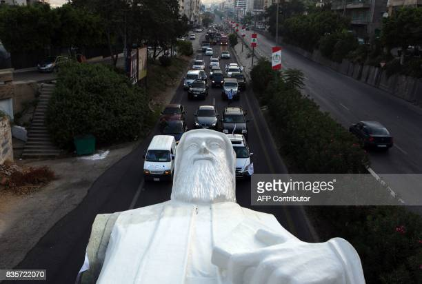 A picture taken on August 20 shows a statue of Lebanese Christian Maronite monk Saint Charbel weighing 40 tons and measuring 23 meters being...