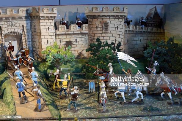 Picture taken on August 2018 shows diorama of Joan of Arc on her horse during the taking of Orleans at the CBG Mignot workshop in La BreilleLesPins...