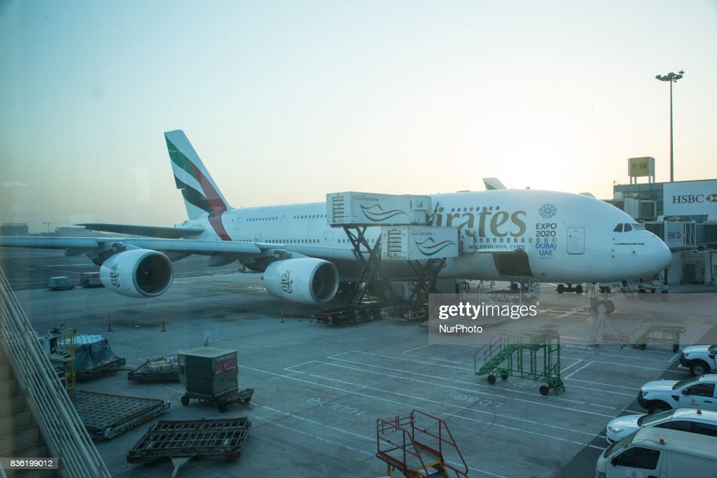 A picture taken on August 21, 2017 shows an Emirates airline Boeing 777 parked on the tarmac at Dubai airport, UAE. Dubai International Airport, the largest airport in space in the world and busiest airport by international passenger traffic. It is also the 3rd busiest airport in the world by total passenger traffic. About 84.000.000 million passengers passed in 2016 from DXB. Emirates and Fludubai are the primary users of the airport, connecting Middle East to all over the world. Also FedEx Express and Qantas uses the airport as a hub.