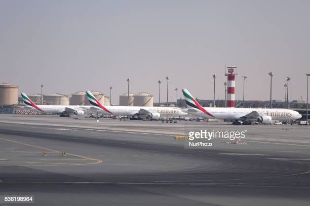 A picture taken on August 21 2017 shows Emirates airline Boeing 777 parked on the tarmac at Dubai airport UAE Dubai International Airport the largest...