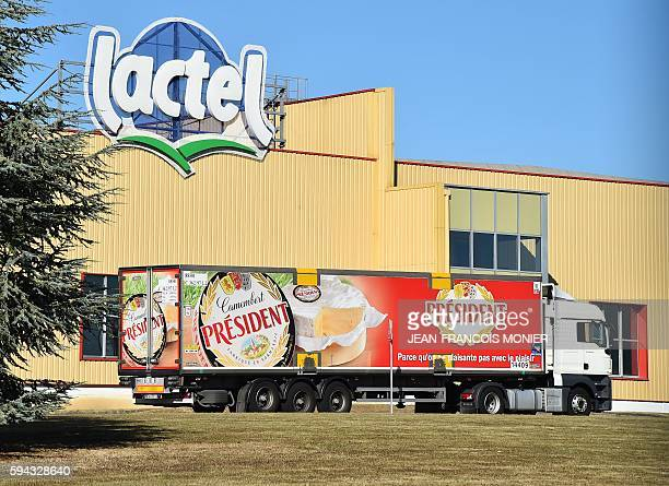 A picture taken on August 22 2016 shows a President truck parked in front of the logo of Lactel a brand of Lactalis at the headquarters in Change...